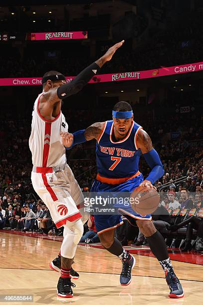 Carmelo Anthony of the New York Knicks drives to the basket against the Toronto Raptors during the game on November 10 2015 at Air Canada Centre in...
