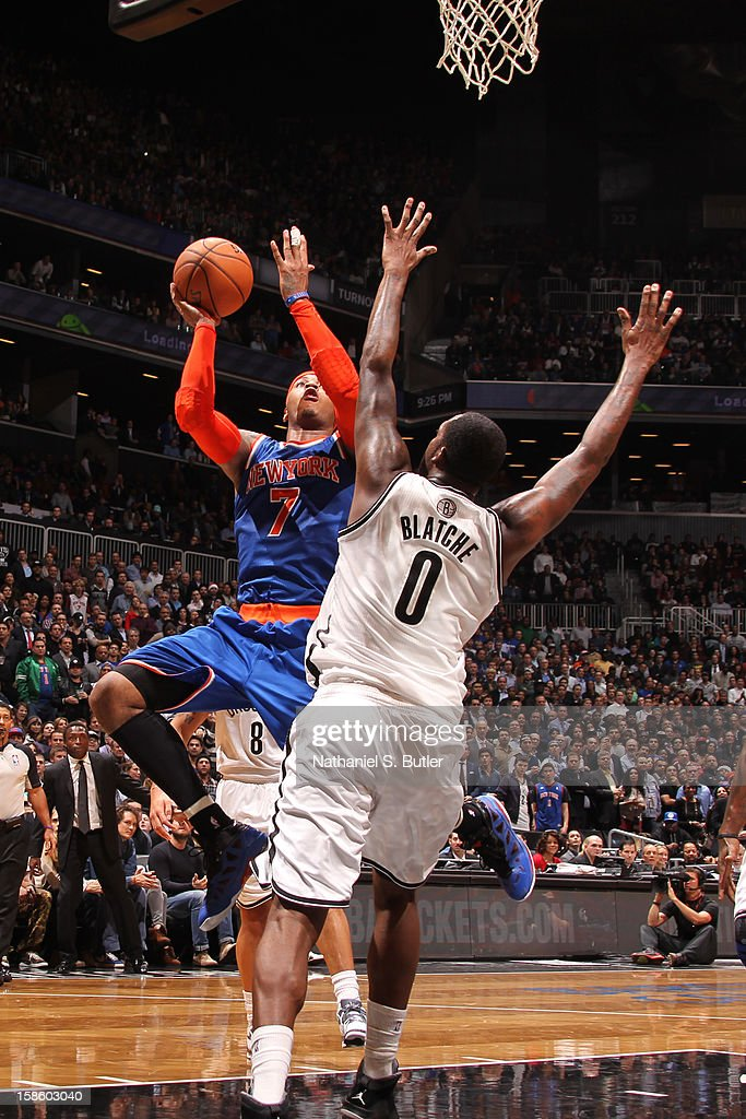 Carmelo Anthony #7 of the New York Knicks drives to the basket and puts up a shot over Andray Blatche #0 of the Brooklyn Nets on December 11, 2012 at the Barclays Center in the Brooklyn borough of New York City.