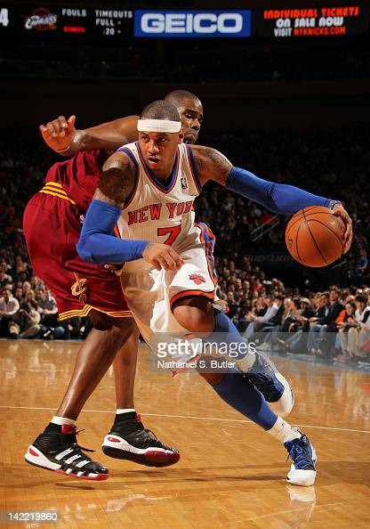 Carmelo Anthony of the New York Knicks drives to the basket around Antawn Jamison of the Cleveland Cavaliers during the game on March 31 2012 at...
