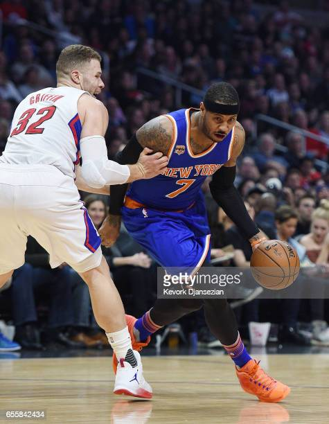 Carmelo Anthony of the New York Knicks drives to the basket under pressure from Blake Griffin of the Los Angeles Clippers during the basketball game...