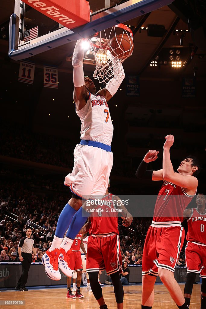 Carmelo Anthony #7 of the New York Knicks dunks against Ersan Ilyasova #7 of the Milwaukee Bucks on April 5, 2013 at Madison Square Garden in New York City.