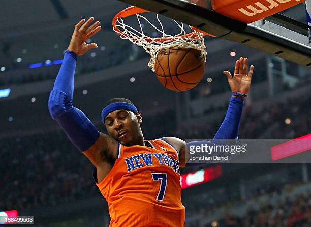 Carmelo Anthony of the New York Knicks dunks against the Chicago Bulls at the United Center on October 31 2013 in Chicago Illinois NOTE TO USER User...