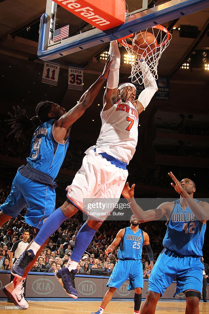 Carmelo Anthony #7 of the New York Knicks dunks the ball against Jae Crowder #9 of the Dallas Mavericks during the game on November 9, 2012 at Madison Square Garden in New York City.