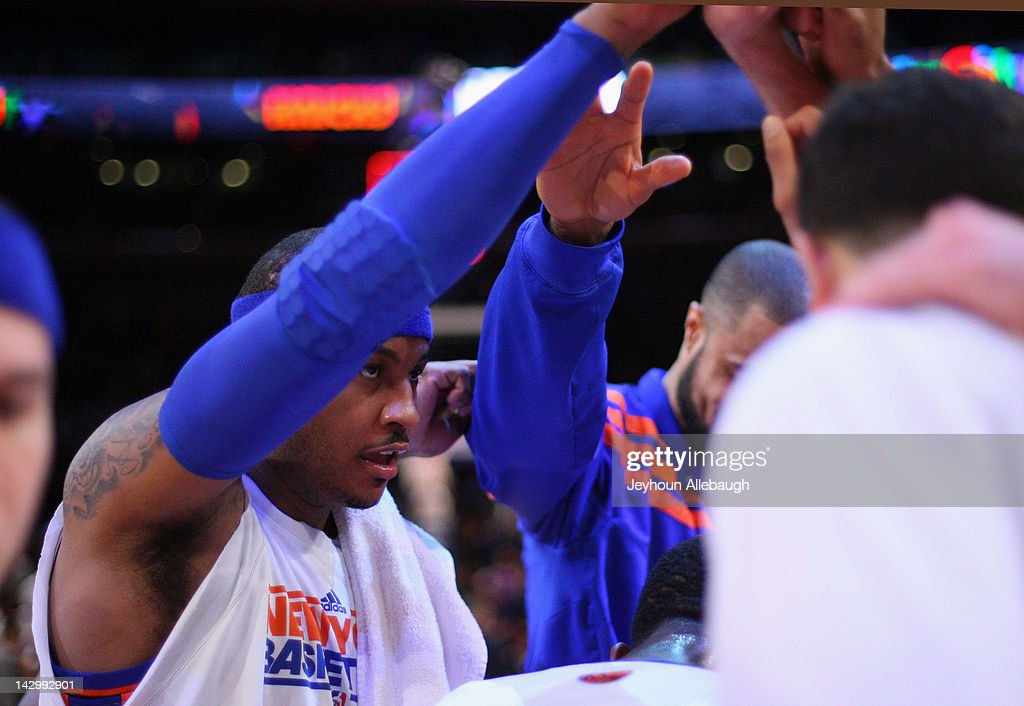 <a gi-track='captionPersonalityLinkClicked' href=/galleries/search?phrase=Carmelo+Anthony&family=editorial&specificpeople=201494 ng-click='$event.stopPropagation()'>Carmelo Anthony</a> #7 of the New York Knicks gathers with members of his team in a huddle prior to the game against the Washington Wizards on April 13, 2012 at Madison Square Garden in New York City.