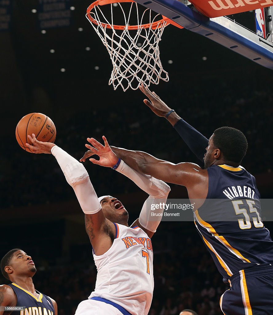 Carmelo Anthony #7 of the New York Knicks gets the shot off against Roy Hibbert #55 of the Indiana Pacers at Madison Square Garden on November 18, 2012 in New York City.