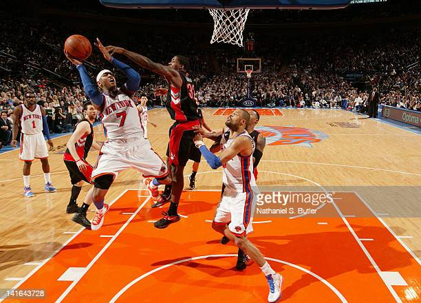 Carmelo Anthony of the New York Knicks goes to the basket against Ed Davis of the Toronto Raptors during the game on March 20 2012 at Madison Square...