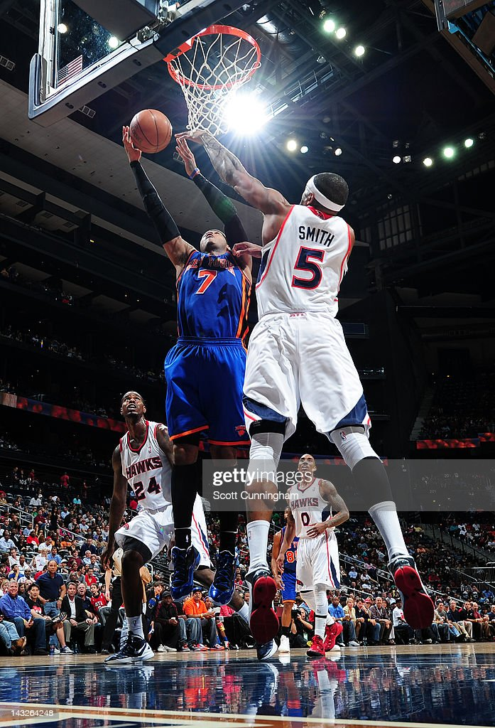 <a gi-track='captionPersonalityLinkClicked' href=/galleries/search?phrase=Carmelo+Anthony&family=editorial&specificpeople=201494 ng-click='$event.stopPropagation()'>Carmelo Anthony</a> #7 of the New York Knicks goes to the basket against <a gi-track='captionPersonalityLinkClicked' href=/galleries/search?phrase=Josh+Smith+-+Basketball+Player+-+Born+1985&family=editorial&specificpeople=201983 ng-click='$event.stopPropagation()'>Josh Smith</a> #5 of the Atlanta Hawks on April 22, 2012 at Philips Arena in Atlanta, Georgia.