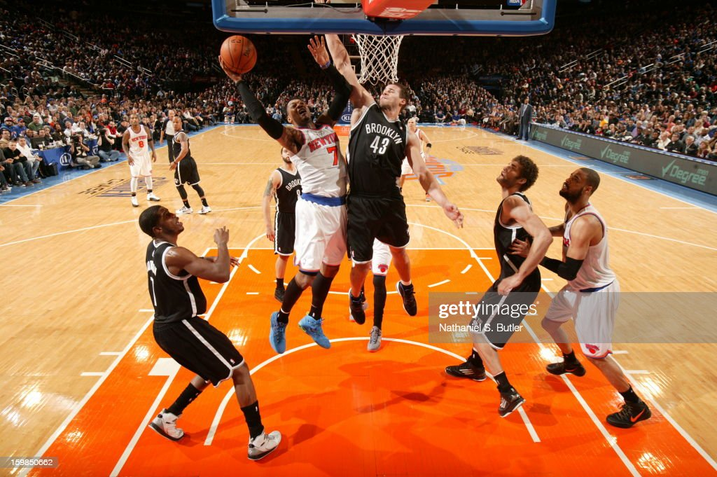 Carmelo Anthony #7 of the New York Knicks goes to the basket against Kris Humphries #43 of the Brooklyn Nets on January 21, 2013 at Madison Square Garden in New York City.