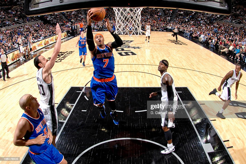 Carmelo Anthony #7 of the New York Knicks goes to the basket against the San Antonio Spurs on November 15, 2012 at the AT&T Center in San Antonio, Texas.
