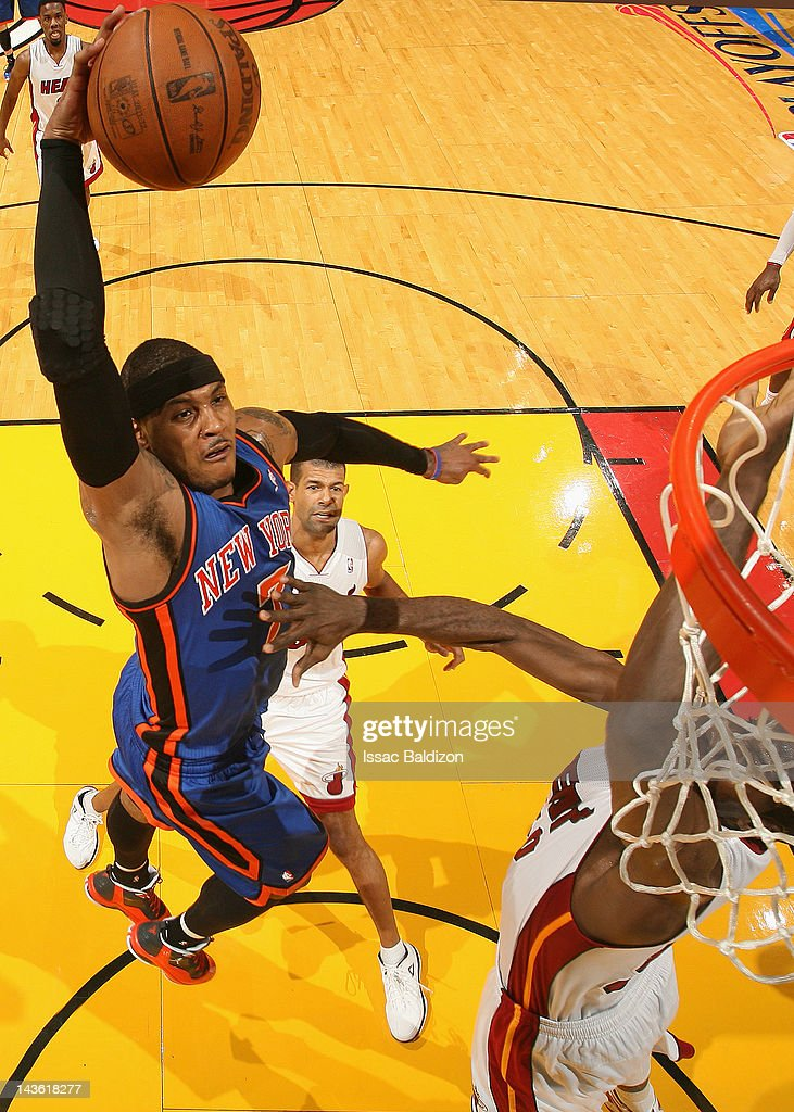 <a gi-track='captionPersonalityLinkClicked' href=/galleries/search?phrase=Carmelo+Anthony&family=editorial&specificpeople=201494 ng-click='$event.stopPropagation()'>Carmelo Anthony</a> #7 of the New York Knicks goes to the basket in Game Two of the Eastern Conference Quarterfinals against the Miami Heat during the 2012 NBA Playoffs on April 30, 2012 at American Airlines Arena in Miami, Florida.