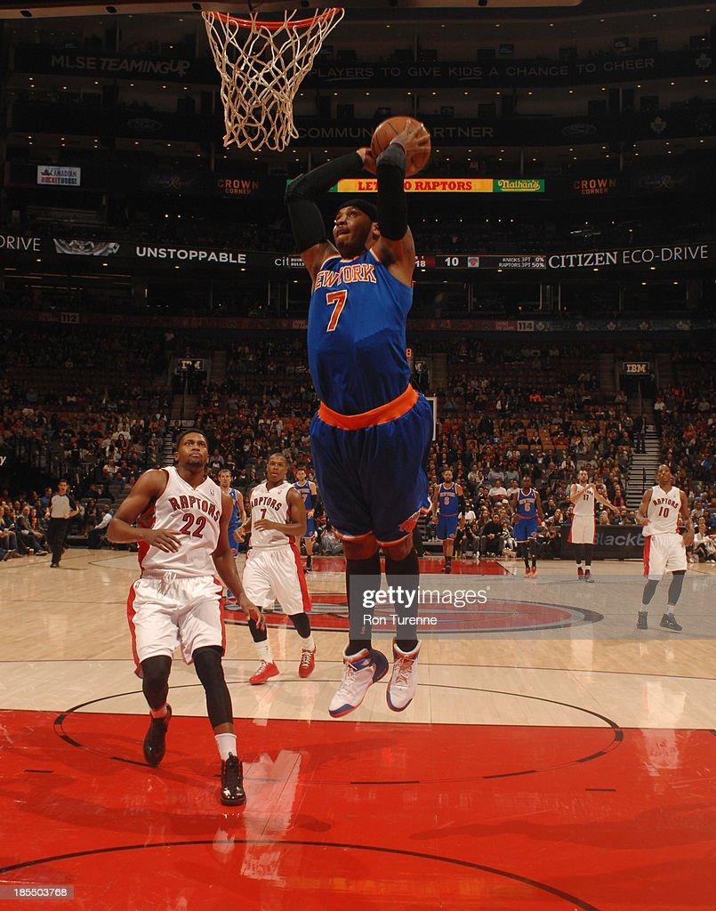 Carmelo Anthony #7 of the New York Knicks goes up for the dunk against the Toronto Raptors during the game on October 21, 2013 at the Air Canada Centre in Toronto, Ontario, Canada.