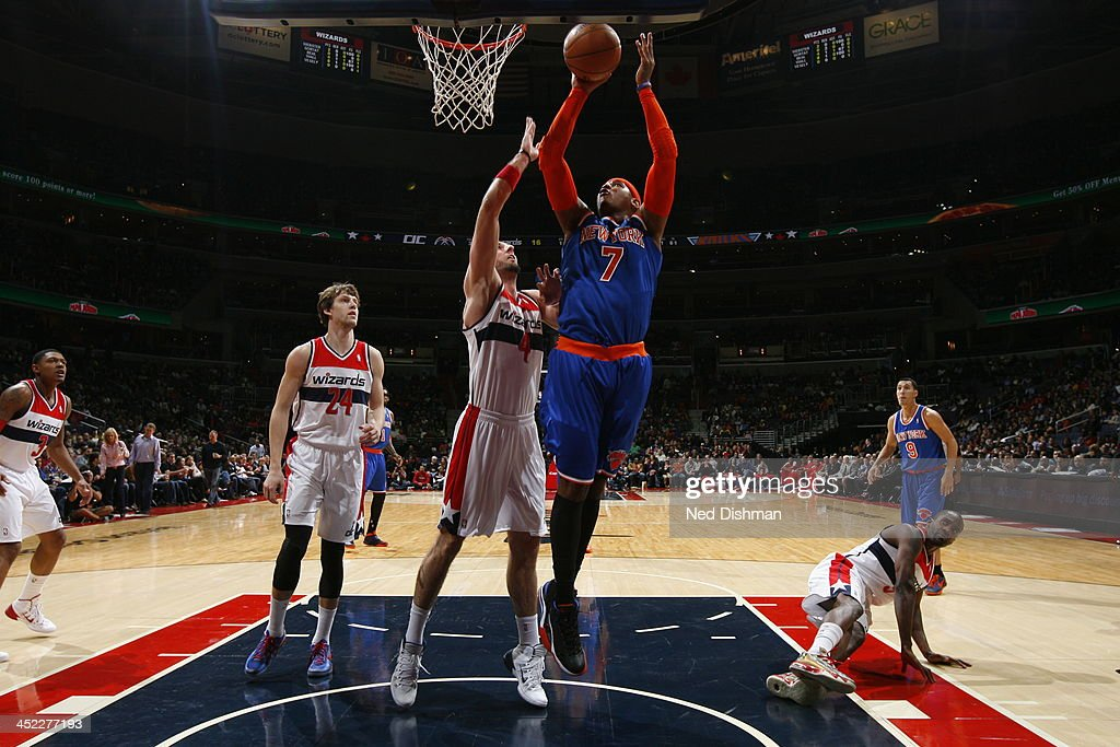 <a gi-track='captionPersonalityLinkClicked' href=/galleries/search?phrase=Carmelo+Anthony&family=editorial&specificpeople=201494 ng-click='$event.stopPropagation()'>Carmelo Anthony</a> #7 of the New York Knicks goes up for the layup against the Washington Wizards during the game at the Verizon Center on November 23, 2013 in Washington, DC.