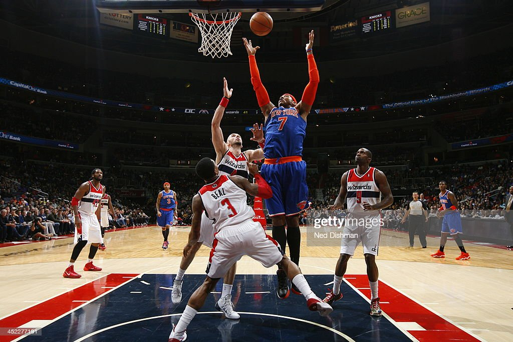 <a gi-track='captionPersonalityLinkClicked' href=/galleries/search?phrase=Carmelo+Anthony&family=editorial&specificpeople=201494 ng-click='$event.stopPropagation()'>Carmelo Anthony</a> #7 of the New York Knicks goes up for the rebound against the Washington Wizards during the game at the Verizon Center on November 23, 2013 in Washington, DC.