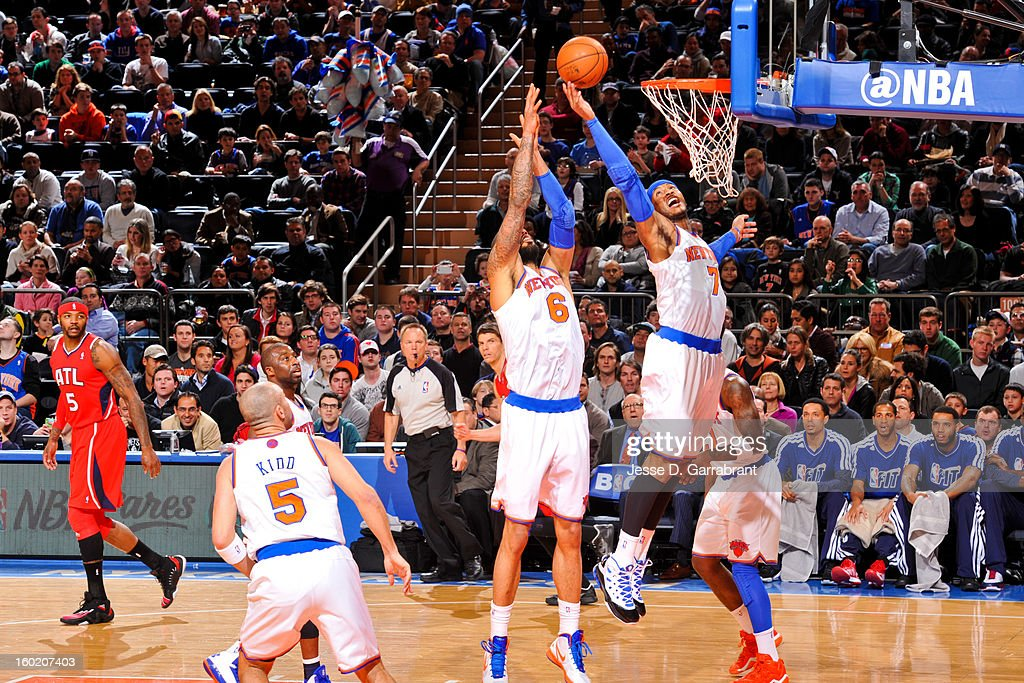 Carmelo Anthony #7 of the New York Knicks grabs a rebound against the Atlanta Hawks at Madison Square Garden on January 27, 2013 in New York, New York.