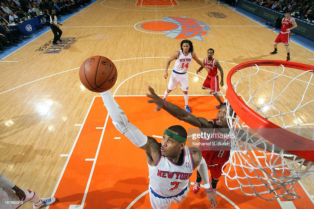<a gi-track='captionPersonalityLinkClicked' href=/galleries/search?phrase=Carmelo+Anthony&family=editorial&specificpeople=201494 ng-click='$event.stopPropagation()'>Carmelo Anthony</a> #7 of the New York Knicks grabs a rebound against the Milwaukee Bucks on April 5, 2013 at Madison Square Garden in New York City.