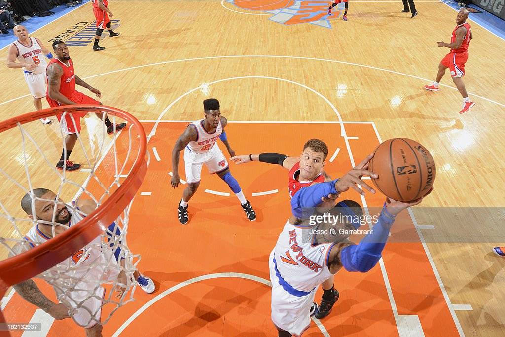 Carmelo Anthony #7 of the New York Knicks grabs the rebound against Blake Griffin #32 of the Los Angeles Clippers on February 10, 2013 at Madison Square Garden in New York City.