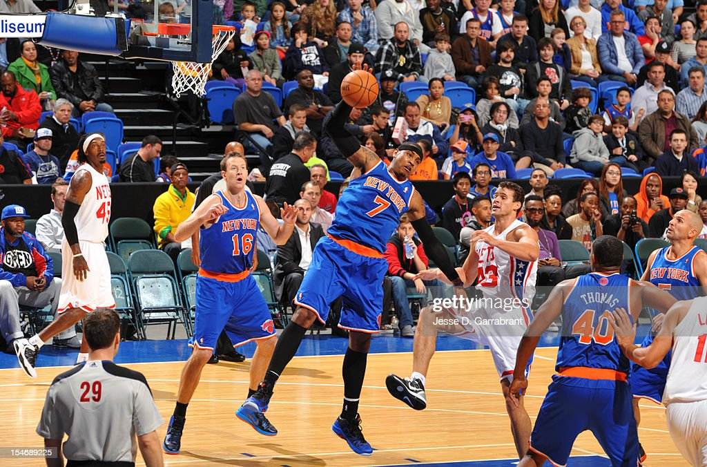 Carmelo Anthony #7 of the New York Knicks grabs the rebound against the Brooklyn Nets on October 24, 2012 at the Nassau Veterans Memorial Coliseum in Long Island, New York.