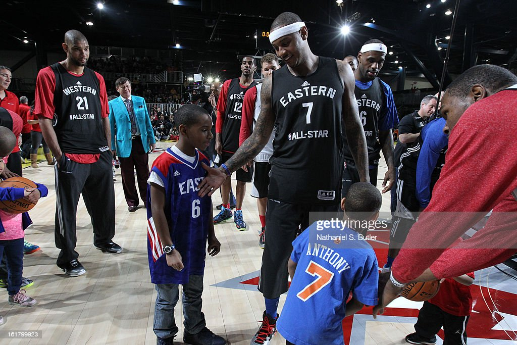 Carmelo Anthony #7 of the New York Knicks greets a fan during the NBA All-Star Practice in Sprint Arena at Jam Session at Jam Session during NBA All Star Weekend on February 16, 2013 at the George R. Brown in Houston, Texas.