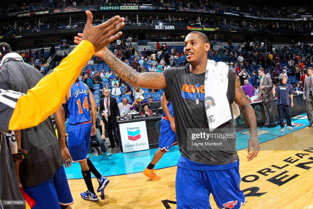 <a gi-track='captionPersonalityLinkClicked' href=/galleries/search?phrase=Carmelo+Anthony&family=editorial&specificpeople=201494 ng-click='$event.stopPropagation()'>Carmelo Anthony</a> #7 of the New York Knicks greets New Orleans Hornets players following the Knicks victory on November 20, 2012 at the New Orleans Arena in New Orleans, Louisiana.