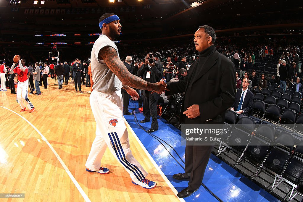 Carmelo Anthony #7 of the New York Knicks greets The Reverend Jesse Jackson before a game against the Boston Celtics at Madison Square Garden in New York City on January 28, 2014.