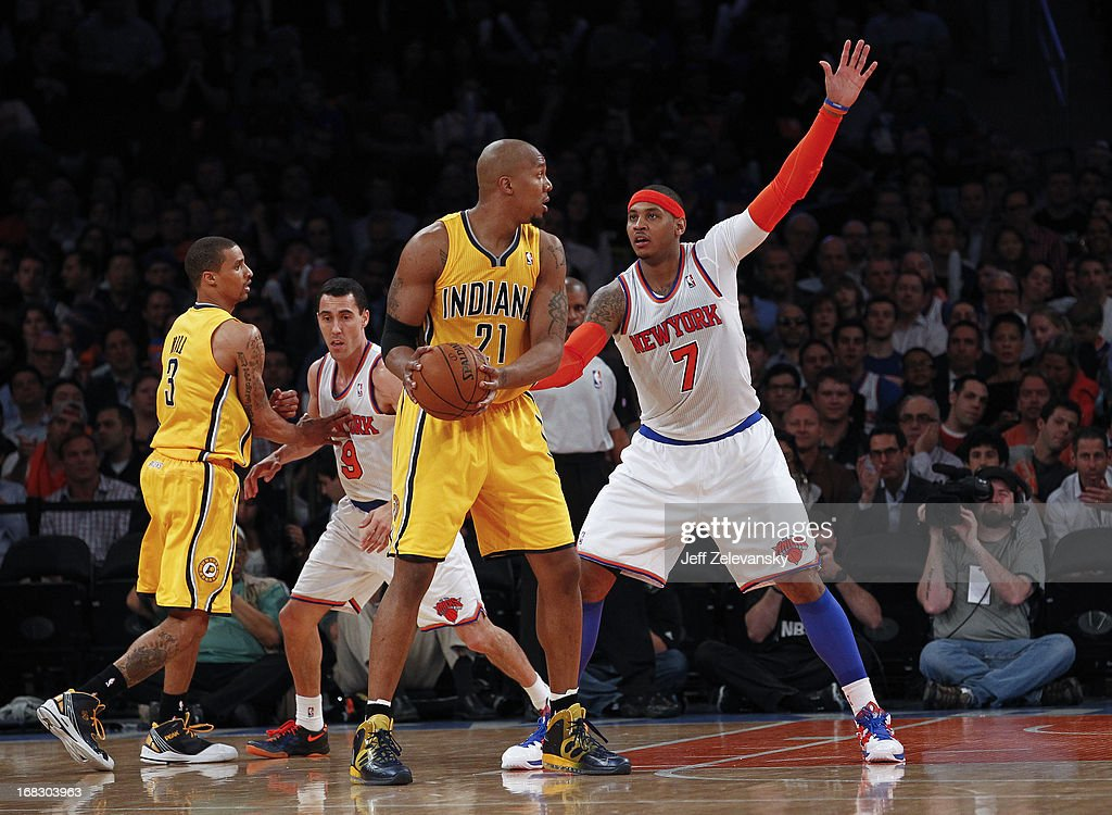 Carmelo Anthony of the New York Knicks guards David West of the Indiana Pacers during Game Two of the Eastern Conference Semifinals of the 2013 NBA...