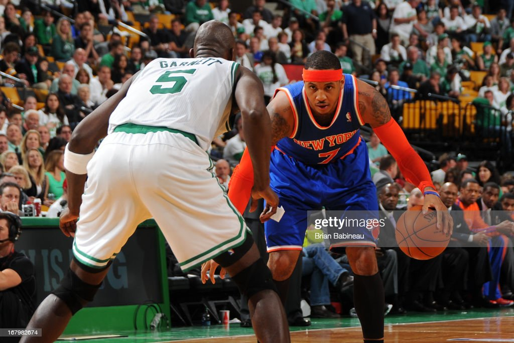 Carmelo Anthony #7 of the New York Knicks handles the ball against Kevin Garnett #5 of the Boston Celtics in Game Six of the Eastern Conference Quarterfinals during the NBA Playoffs on May 3, 2013 at the TD Garden in Boston, Massachusetts.