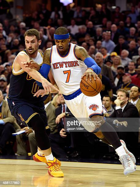 Carmelo Anthony of the New York Knicks handles the ball against Kevin Love of the Cleveland Cavaliers in the first quarter at Quicken Loans Arena on...