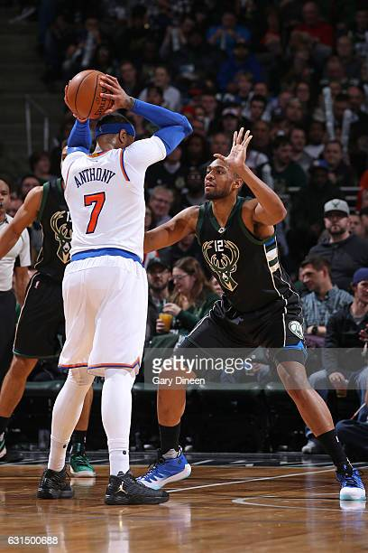 Carmelo Anthony of the New York Knicks handles the ball against Jabari Parker of the Milwaukee Bucks during a game on January 6 2017 at the BMO...