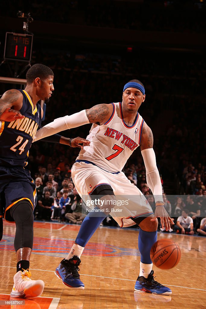 <a gi-track='captionPersonalityLinkClicked' href=/galleries/search?phrase=Carmelo+Anthony&family=editorial&specificpeople=201494 ng-click='$event.stopPropagation()'>Carmelo Anthony</a> #7 of the New York Knicks handles the ball against Paul George #24 of the Indiana Pacers on April 14, 2013 at Madison Square Garden in New York City.