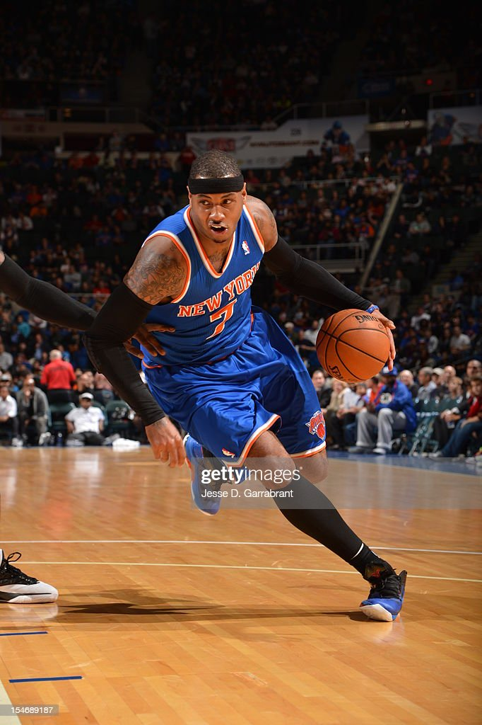 Carmelo Anthony #7 of the New York Knicks handles the ball against the Brooklyn Nets on October 24, 2012 at the Nassau Veterans Memorial Coliseum in Long Island, New York.
