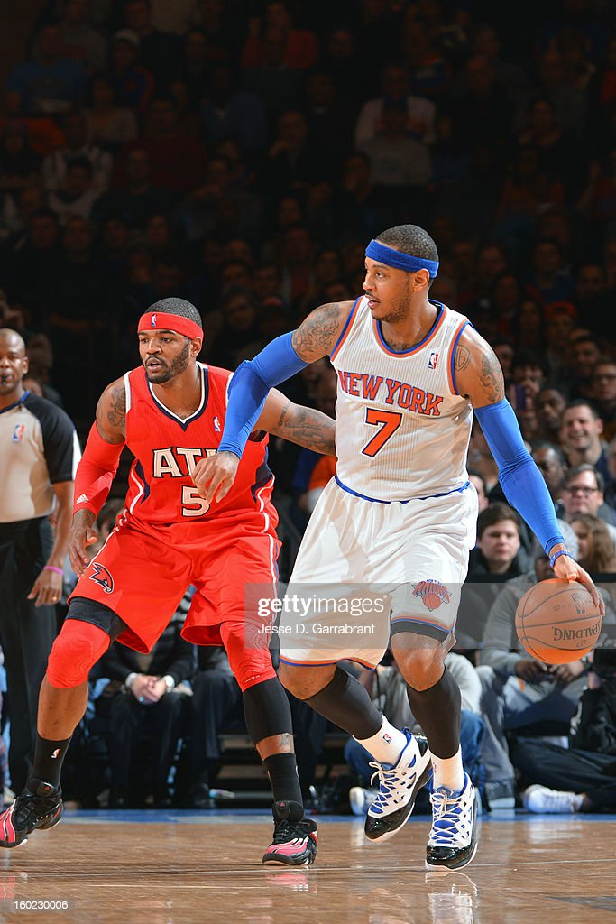 Carmelo Anthony #7 of the New York Knicks handles the ball Atlanta Hawks during the game at Madison Square Garden on January 27, 2013 in New York, New York.