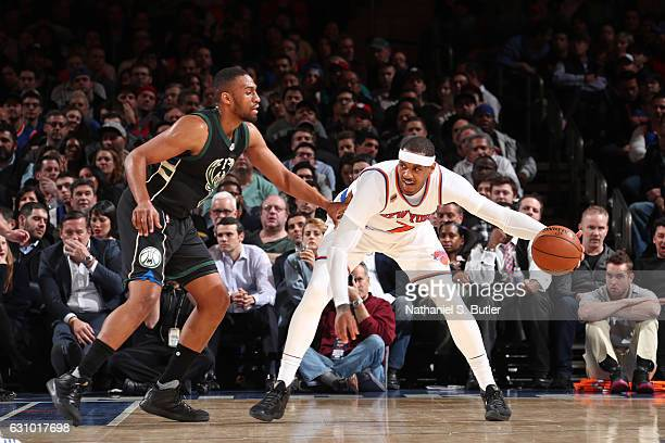 Carmelo Anthony of the New York Knicks handles the ball Jabari Parker of the Milwaukee Bucks on January 4 2017 at Madison Square Garden in New York...
