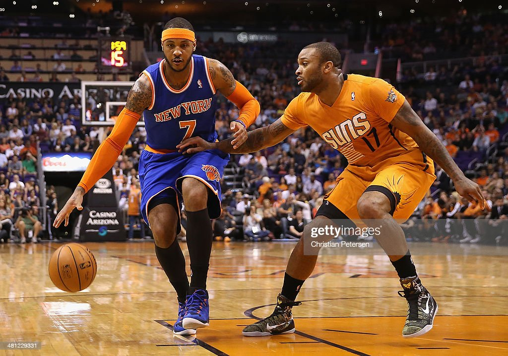 Carmelo Anthony #7 of the New York Knicks handles the ball under pressure from P.J. Tucker #17 of the Phoenix Suns during the first half of the NBA game at US Airways Center on March 28, 2014 in Phoenix, Arizona.