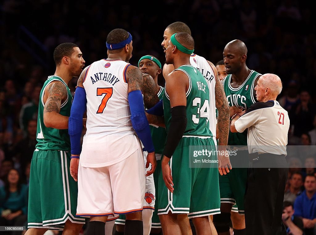 Carmelo Anthony #7 of the New York Knicks has words in the second half with Kevin Garnett #5 of the Boston Celtics at Madison Square Garden on January 7, 2013 in New York City. The Celtics defeated the Knicks 102-96.