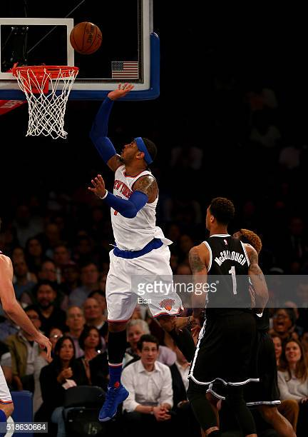 Carmelo Anthony of the New York Knicks heads for the net as Chris McCullough and Sean Kilpatrick of the Brooklyn Nets defend at Madison Square Garden...
