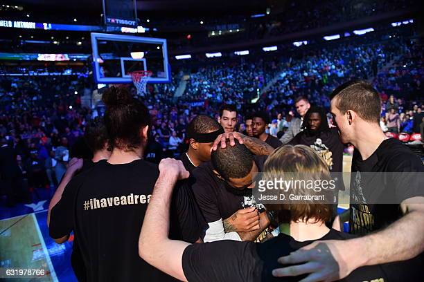 Carmelo Anthony of the New York Knicks huddles up with his teammates before the game against the Atlanta Hawks on January 16 2017 at Madison Square...