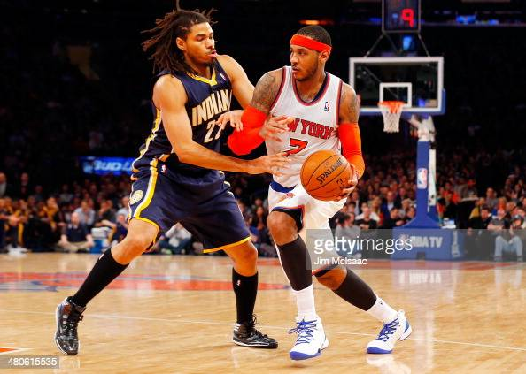 Carmelo Anthony of the New York Knicks in action against Chris Copeland of the Indiana Pacers at Madison Square Garden on March 19 2014 in New York...