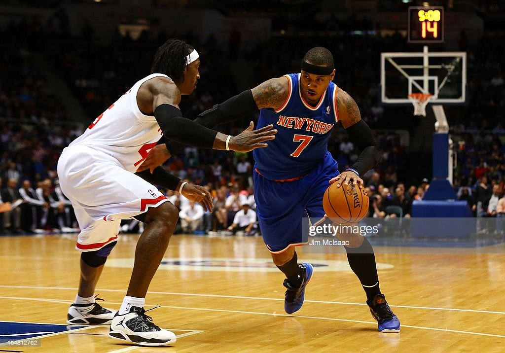 Carmelo Anthony #7 of the New York Knicks in action against Gerald Wallace #45 of the Brooklyn Nets during a preseason game at Nassau Coliseum on October 24 2012 in Uniondale, New York The Knicks defeated the Nets 97-95.