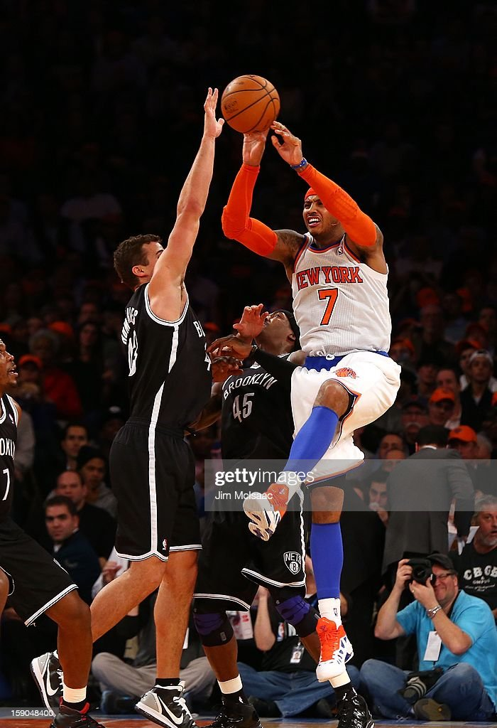 Carmelo Anthony #7 of the New York Knicks in action against Kris Humphries #43 of the Brooklyn Nets at Madison Square Garden on December 19, 2012 in New York City. The Knicks defeated the Nets 100-86.