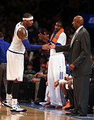 Carmelo Anthony of the New York Knicks is congratulated by head coach Mike Woodson after Anthony was pulled from the game against the Orlando Magic...