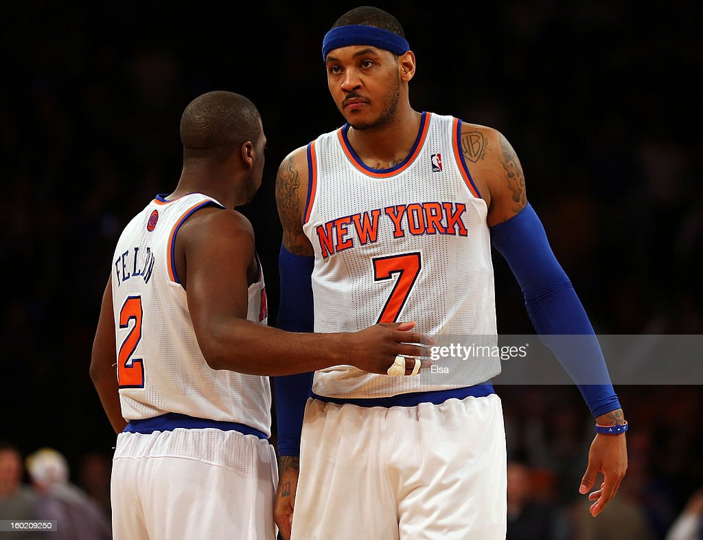 Carmelo Anthony #7 of the New York Knicks is congratulated by teammate Raymond Felton #2 after Anthony scored the game winning basket and drew the foul in the final minute against the Atlanta Hawks on January 27, 2013 at Madison Square Garden in New York City. The New York Knicks defeated the Atlanta Hawks 106-104.