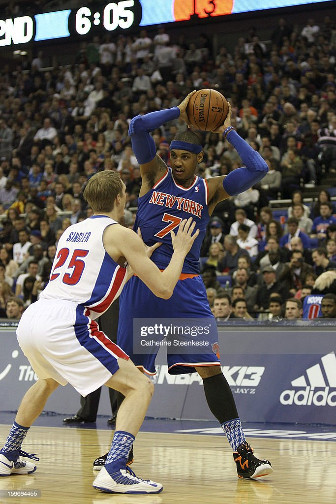 <a gi-track='captionPersonalityLinkClicked' href=/galleries/search?phrase=Carmelo+Anthony&family=editorial&specificpeople=201494 ng-click='$event.stopPropagation()'>Carmelo Anthony</a> #7 of the New York Knicks is trying to pass the ball over <a gi-track='captionPersonalityLinkClicked' href=/galleries/search?phrase=Kyle+Singler&family=editorial&specificpeople=4216029 ng-click='$event.stopPropagation()'>Kyle Singler</a> #25 of the Detroit Pistons during a game between the New York Knicks and the Detroit Pistons at the O2 Arena on January 17, 2013 in London, England.