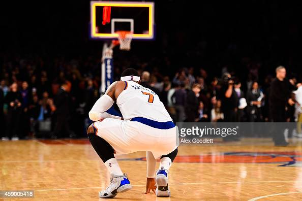Carmelo Anthony of the New York Knicks kneels down after losing to the Utah Jazz at Madison Square Garden on November 14 2014 in New York City NOTE...