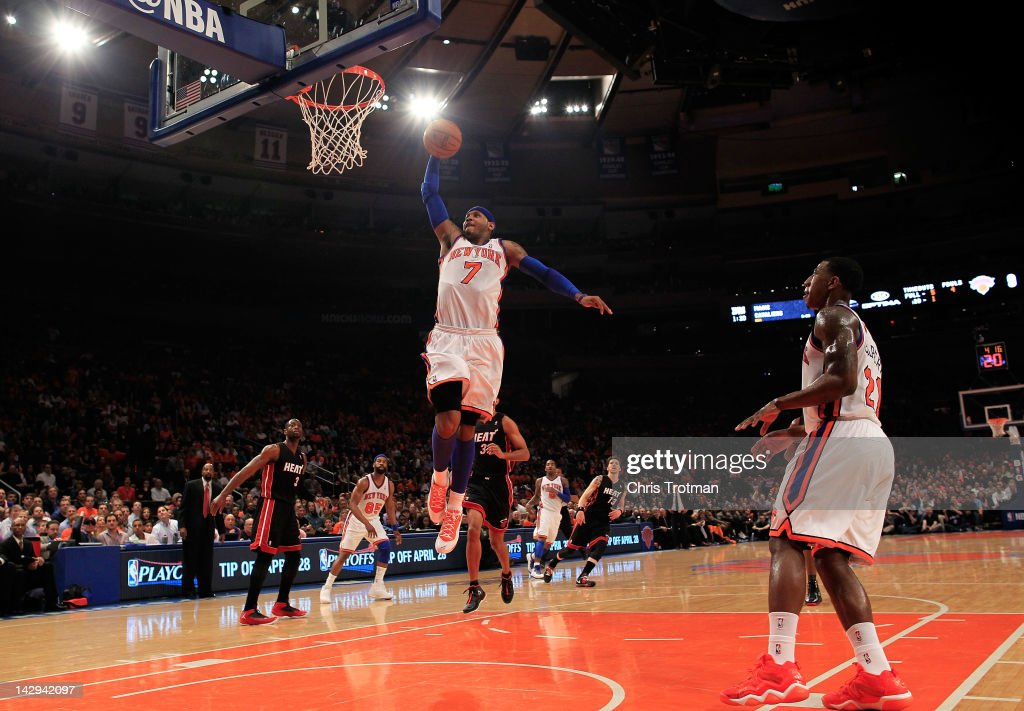 <a gi-track='captionPersonalityLinkClicked' href=/galleries/search?phrase=Carmelo+Anthony&family=editorial&specificpeople=201494 ng-click='$event.stopPropagation()'>Carmelo Anthony</a> #7 of the New York Knicks lays the ball up against the Miami Heat at Madison Square Garden on April 15, 2012 in New York City.