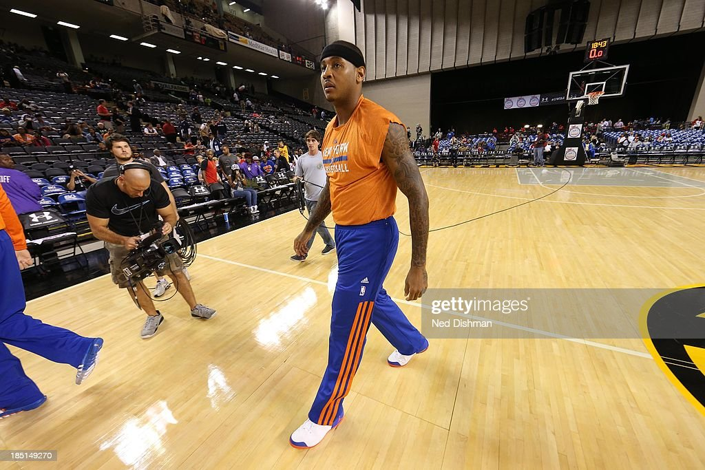 Carmelo Anthony #7 of the New York Knicks leaves the court after warmups against the Washington Wizards during the pre-season game at the Baltimore Arena on October 17, 2013 in Baltimore, MD.