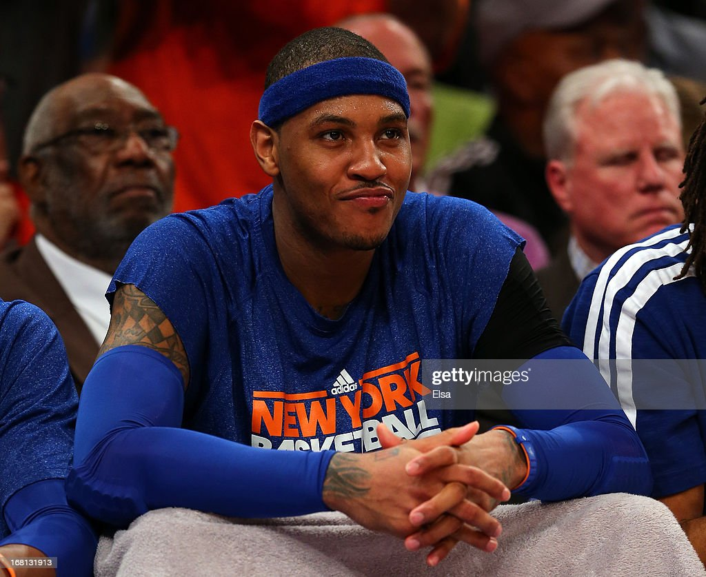 <a gi-track='captionPersonalityLinkClicked' href=/galleries/search?phrase=Carmelo+Anthony&family=editorial&specificpeople=201494 ng-click='$event.stopPropagation()'>Carmelo Anthony</a> #7 of the New York Knicks looks on from the bench in the third quarter against the Indiana Pacers during Game One of the Eastern Conference Semifinals of the 2013 NBA Playoffs on May 5, 2013 at Madison Square Garden in New York City. The Indiana Pacers defeated the New York Knicks 102-95.