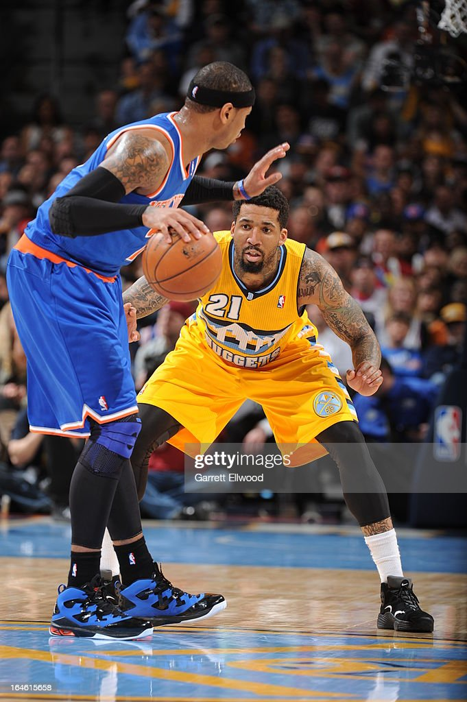 Carmelo Anthony #7 of the New York Knicks looks to drive to the basket against Wilson Chandler #21 of the Denver Nuggets on March 13, 2013 at the Pepsi Center in Denver, Colorado.