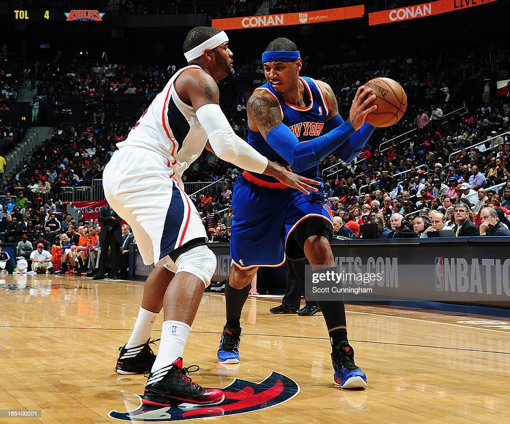 <a gi-track='captionPersonalityLinkClicked' href=/galleries/search?phrase=Carmelo+Anthony&family=editorial&specificpeople=201494 ng-click='$event.stopPropagation()'>Carmelo Anthony</a> #7 of the New York Knicks looks to drive to the basket against <a gi-track='captionPersonalityLinkClicked' href=/galleries/search?phrase=Josh+Smith+-+Basketball+Player+-+Born+1985&family=editorial&specificpeople=201983 ng-click='$event.stopPropagation()'>Josh Smith</a> #5 of the Atlanta Hawks on April 3, 2013 at Philips Arena in Atlanta, Georgia.