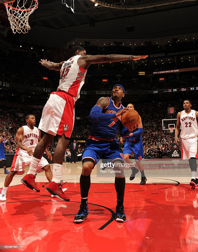 <a gi-track='captionPersonalityLinkClicked' href=/galleries/search?phrase=Carmelo+Anthony&family=editorial&specificpeople=201494 ng-click='$event.stopPropagation()'>Carmelo Anthony</a> #7 of the New York Knicks looks to go the basket against <a gi-track='captionPersonalityLinkClicked' href=/galleries/search?phrase=Amir+Johnson&family=editorial&specificpeople=556786 ng-click='$event.stopPropagation()'>Amir Johnson</a> #15 of the Toronto Raptors on February 22, 2013 at the Air Canada Centre in Toronto, Ontario, Canada.