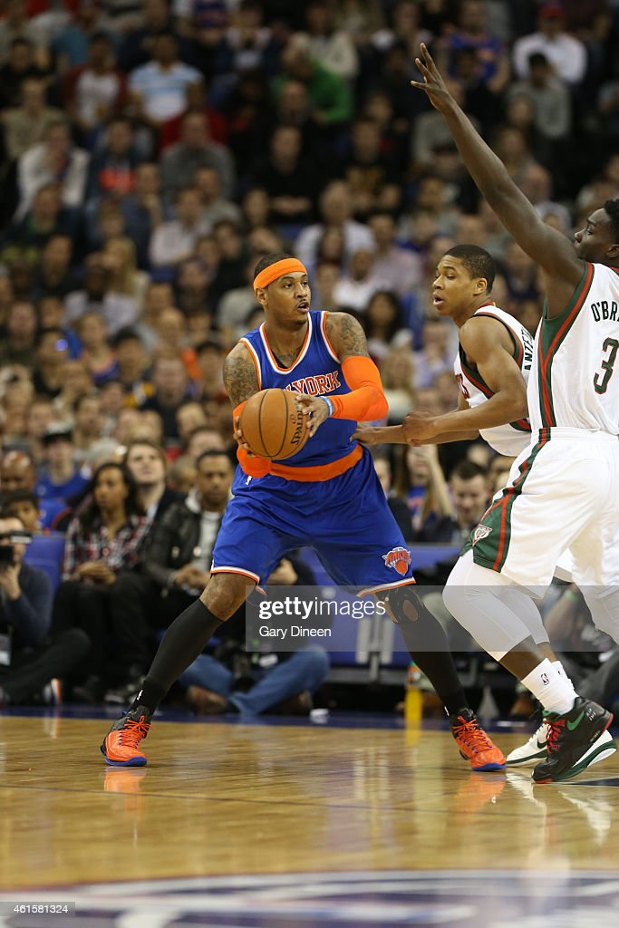 <a gi-track='captionPersonalityLinkClicked' href=/galleries/search?phrase=Carmelo+Anthony&family=editorial&specificpeople=201494 ng-click='$event.stopPropagation()'>Carmelo Anthony</a> #7 of the New York Knicks looks to pass while defended by <a gi-track='captionPersonalityLinkClicked' href=/galleries/search?phrase=Giannis+Antetokounmpo&family=editorial&specificpeople=11078379 ng-click='$event.stopPropagation()'>Giannis Antetokounmpo</a> #34 and Johnny O'Bryant #3 of the Milwaukee Bucks as part of the 2015 Global Games on January 15, 2015 at The O2 Arena in London, England.
